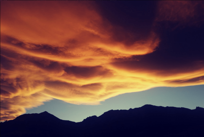 A wave cloud sunset over the Front Range. (National Weather Service)