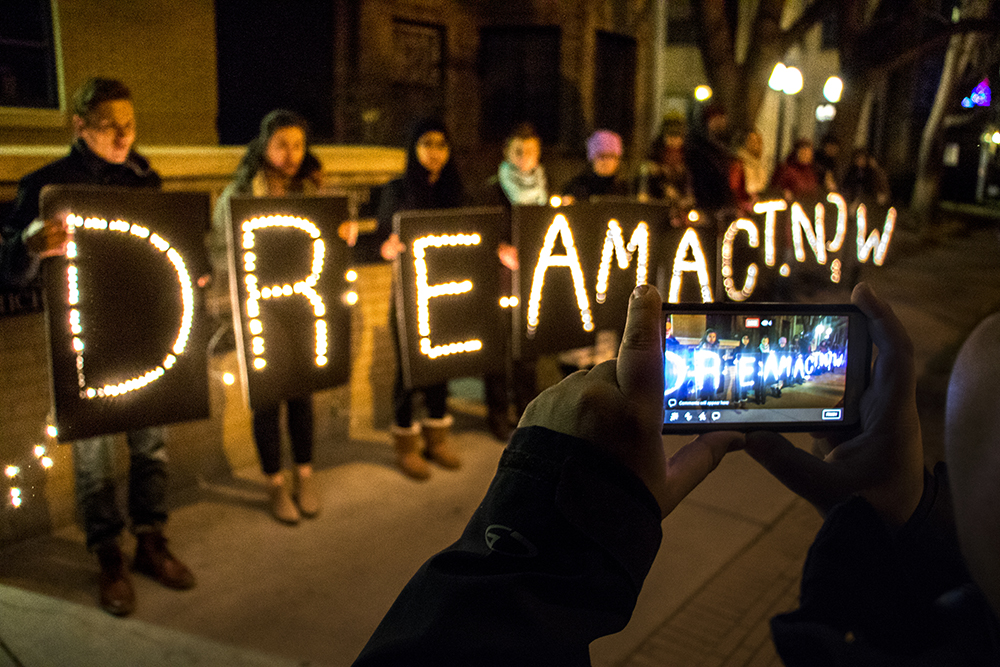 """The Colorado Immigrants Rights Coalition holds a short vigil outside Senator Michael Bennet's office in Capitol Hill asking for a """"clean"""" DREAM Act bill, Dec. 8, 2017. (Kevin J. Beaty/Denverite)  denver; colorado; immigration; protest; daca; circ; colorado immigrants rights coalition; denverite; capitol hill;"""