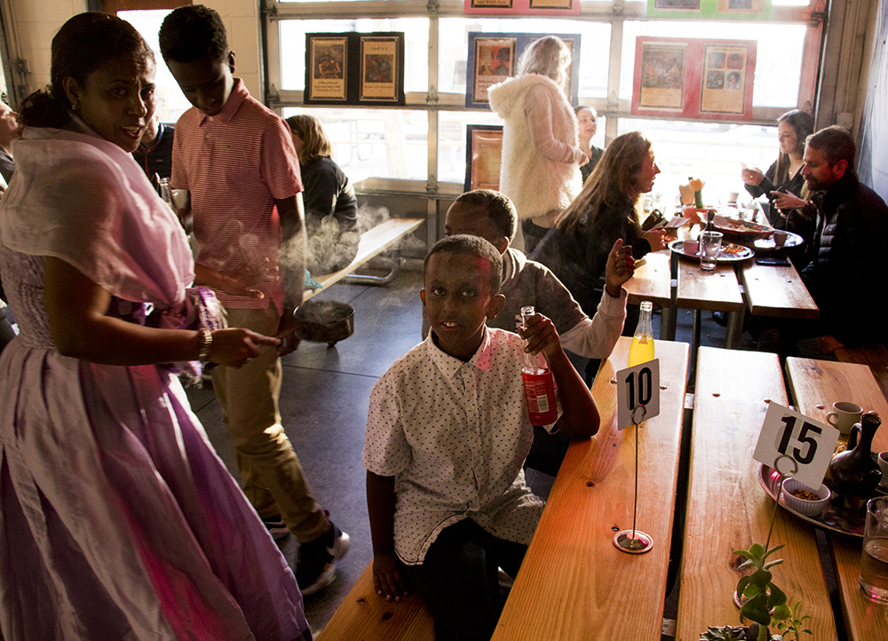 Sara Gebre and three of her four boys. Ethiopian coffee service gets kicked off at Comal Kitchen, Dec. 14, 2017. (Kevin J. Beaty/Denverite)