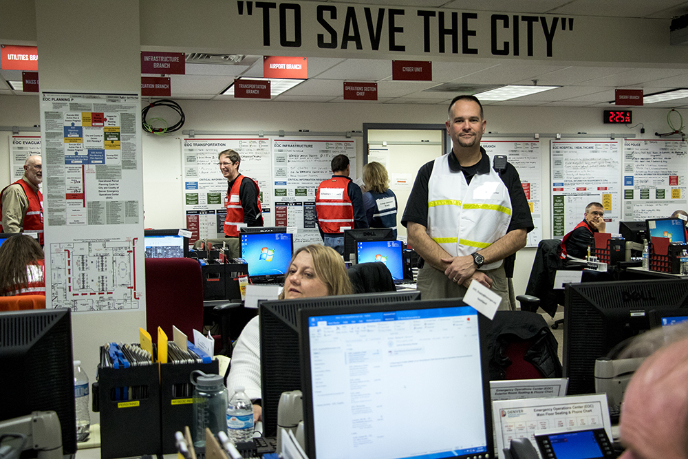 Ryan Broughton, executive director of the Mayor's Office of Emergency Management, poses for a photo in the basement crisis center at the City and County Building, Dec. 15, 2017. (Kevin J. Beaty/Denverite)  city and county building; oem; Office of Emergency Management; colorado; denver; denverite; kevinjbeaty;