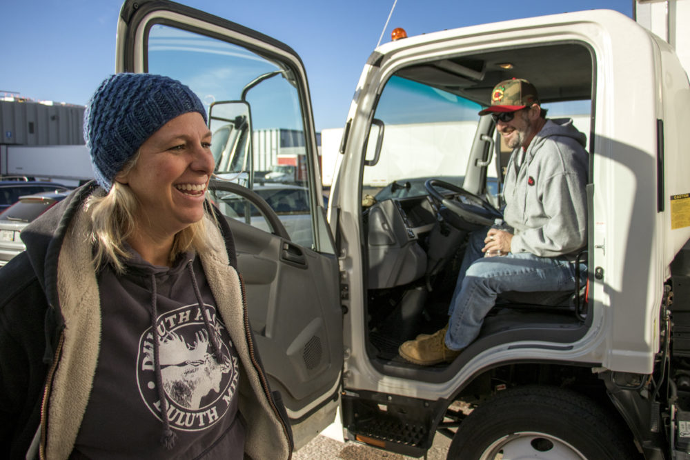Dana Van Daele and Matthew Karm load up for a day of food rescue. A ride-along with We Don't Waste, Dec. 18, 2017 (Kevin J. Beaty/Denverite)  denver; colorado; denverite; food insecurity; food; sustainability;