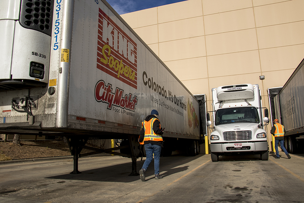 We Don't Waste's truck is dwarfed by those headed to grocery stores at the Suntastic loading dock, Dec. 18, 2017 (Kevin J. Beaty/Denverite)  denver; colorado; denverite; food insecurity; food; sustainability;