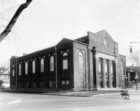 View of Beth Ha-Medrash Hagodol Synagogue at East 16th (Sixteenth) and Gaylord Streets in the City Park West neighborhood of Denver, Colorado; it has columns, a Star of David, and Menorahs. (Denver News/Denver Public Library Western History Collection/X-25547)