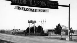 A sign over Colfax Avenue in Aurora. (Courtesy Aurora History Museum Photographic Collections)