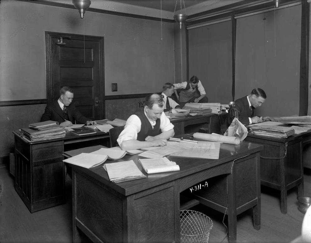 A group of engineers work at desks in an office at the Mountain States Telephone and Telegraph Co. building at 1421 Champa St. circa 1910-1920. (Denver Public Library Western History Collection/CHS.X7491)