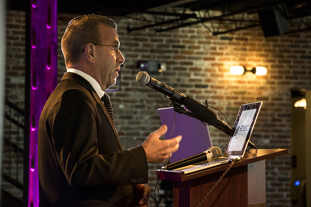 Jeff Shoemaker, Executive Director of The Greenway Foundation, speaks at a Meow Wolf announcement about a new location in Denver, Jan. 4, 2018. (Kevin J. Beaty/Denverite)  meow wolf; diy; art; auraria; west colfax; kevinjbeaty; denver; denverite; colorado;