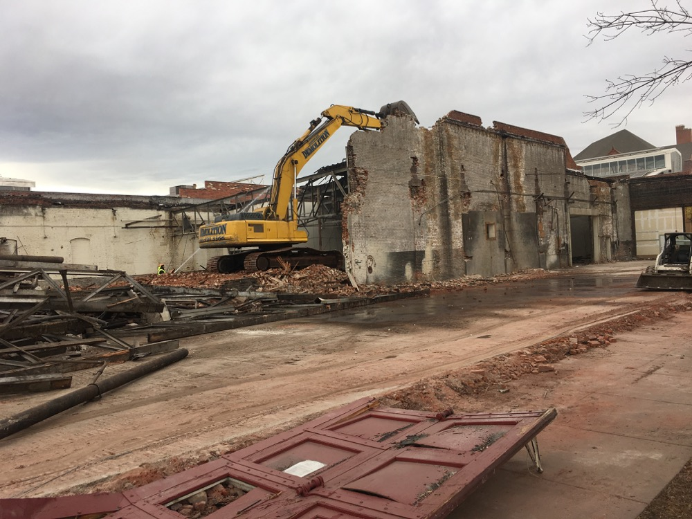 A demolition crew tears down part of a building on the Tramway Nonprofit Center. (Courtesy Urban Land Conservancy)
