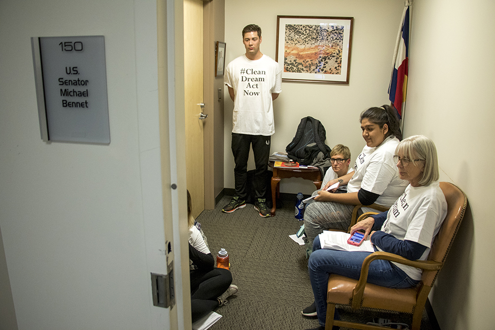 "Patrick Floyd Thibault, center, joins protesters occupying Sen. Michael Bennet's office demanding a ""clean dream act"" to pass the U.S. Senate, Feb. 7, 2018. (Kevin J. Beaty/Denverite)"