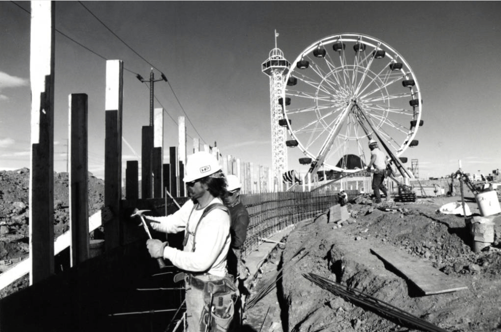 Mike Peak, a carpenter for Hensel Phelps construction, works on concrete forms for the Kiddieland Pond wall, at the new Elitch's. (Steve Groer/Denver Public Library/Western History Collection/	RMN-058-9021)