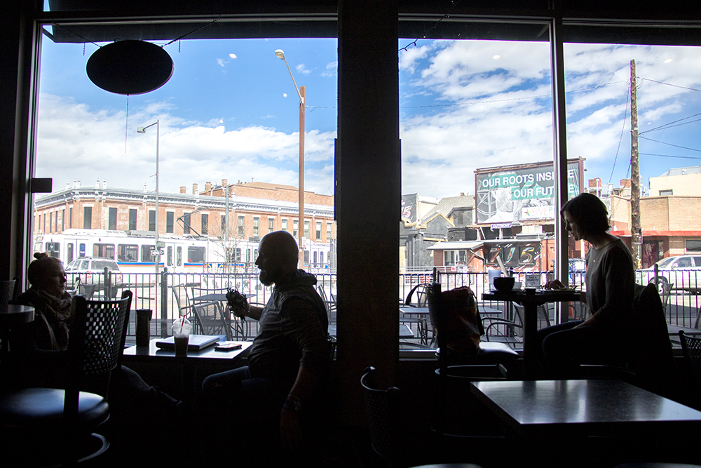 Ane Herad (left to right), Travis Smith and Danielle Vaughan sit by the window inside Coffee at The Point on Welton Street. March 15, 2018. (Kevin J. Beaty/Denverite)  coffee shop; food; five points; denver; denverite; kevinjbeaty; colorado;