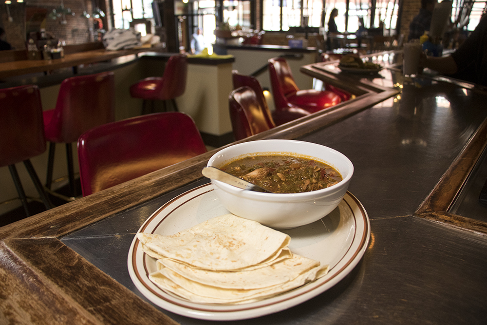 A bowl of green chile on the bar at the Cherry Cricket on Blake Street, which is nearly ready to open, April 16, 2018. (Kevin J. Beaty/Denverite)