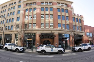 Police cars are parked on Blake Street at the scene of a burglary, April 3, 2018. (Kevin J. Beaty/Denverite)  crime; downtown; denver; police; colorado; kevinjbeaty; denverite;