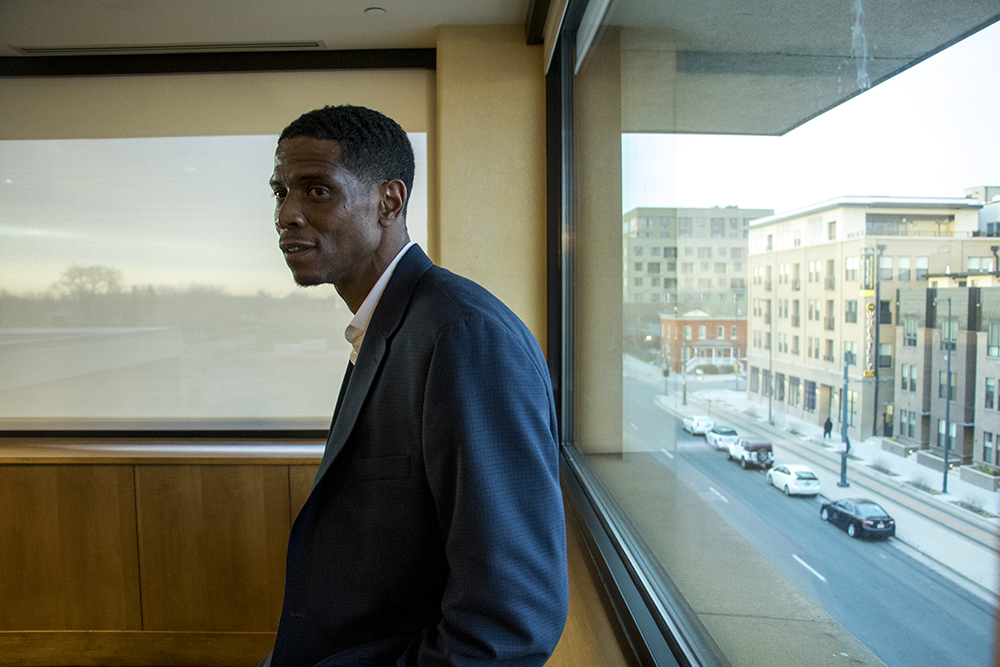 Development partner Norman Harris III listens as he and other developers meet with the Five Points community to announce new plans for the Rossonian Hotel. Blair-Caldwell African American Research Library, April 16, 2018. (Kevin J. Beaty/Denverite)  denver; colorado; denverite; five points; development; welton street; kevinjbeaty;
