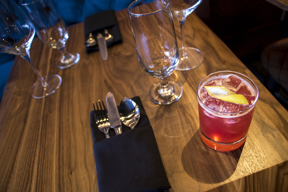 We (Don't) Work, Scotch, lemon, hibiscus flower syrup, soda and a lemon twist. Dead Battery Club on Platte Street, April 26, 2018. (Kevin J. Beaty/Denverite)  denver; colorado; denverite; kevinjbeaty; food; bars; nightlife; highland;