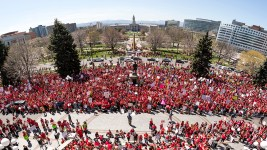 Protesters crowd beneath the State House in protest of a lack of funding for schools, April 27, 2018. (Kevin J. Beaty/Denverite)  redfored; education; teachers; protest; denver; colorado; denverite; kevinjbeaty;
