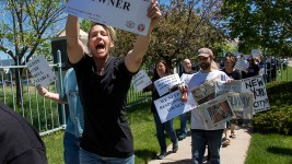 Helen Richardson (left), a Denver Post photogrpaher, yells during a walk-out of the paper's Adams Country headquarters in protest their corporate owners, Alden Global Capital, May 8, 2018. (Kevin J. Beaty/Denverite)  denver post; protest; newsmatters; alden global capitol; denver; colorado; denverite; adams county;