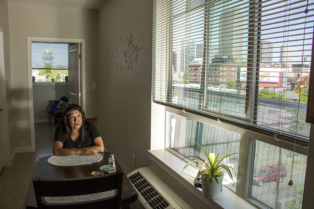 Rosalinda Sanchez in her unit inside the Saint Francis Apartments on Washington Street in Capitol Hill, May 1, 2018. (Kevin J. Beaty/Denverite)  denver; colorado; denverite; kevinjbeaty; affordable housing; religion; capitol hill;