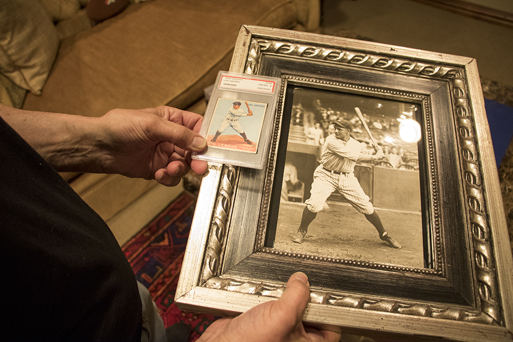 Marshall Fogle holds an original photo of Lou Gehrig and its corresponding German-ink-printed card in his home, a shrine to baseball memorabilia, May 17, 2018. (Kevin J. Beaty/Denverite)