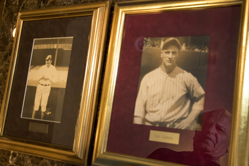 Marshall Fogle peers down at signed portraits of Babe Ruth (left) and Lou Gehrig in his home, a shrine to baseball memorabilia, May 17, 2018. (Kevin J. Beaty/Denverite)  denver; colorado; denverite; baseball; sports; collecting; collector; kevinjbeaty;