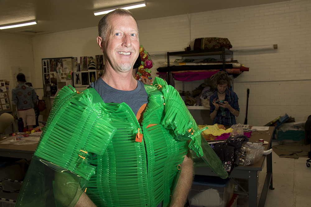 Model Ken Mueller shows off his suit made from an old beach chair. Lonnie Hanzon's Lakewood studio, May 29, 2018. (Kevin J. Beaty/Denverite)  lakewood; colorado; denverite; kevinjbeaty; sustainability; fashion; pridefest; pride; lgbtq; art;