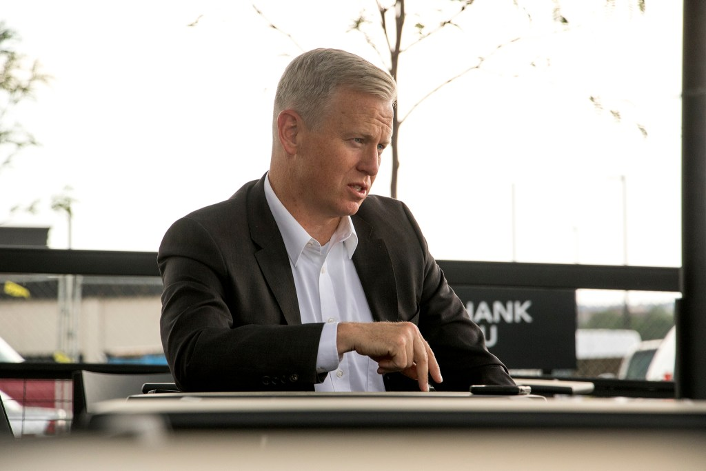 Colorado Attorney General candidate George Brauchler speaks with a reporter, June 15, 2018. (Kevin J. Beaty/Denverite)