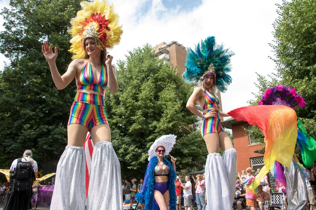 Very tall women march in the Denver PrideFest parade, June 17, 2018. (Kevin J. Beaty/Denverite)
