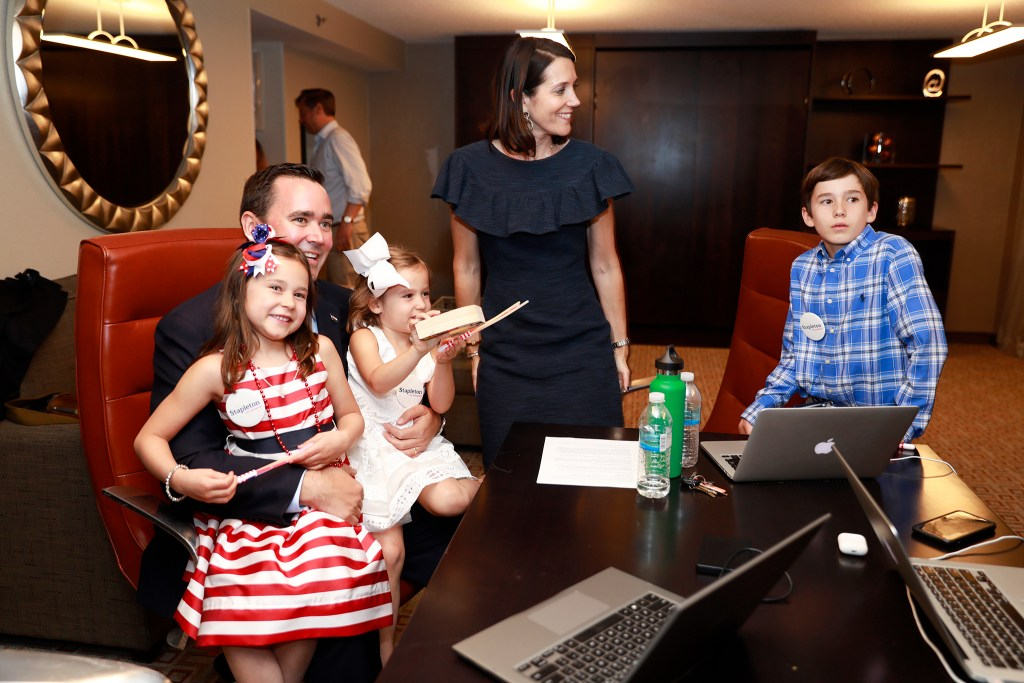 Walker Stapleton watches results roll in with his family during his primary election watch party, June 26, 2018. (Alyson McClaran/For Denverite)