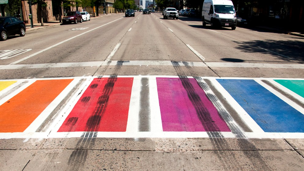 Tire tracks on a rainbow crosswalk across Broadway has raised questions about possible bias-related vandalism, July 6, 2018. (Kevin J. Beaty/Denverite)