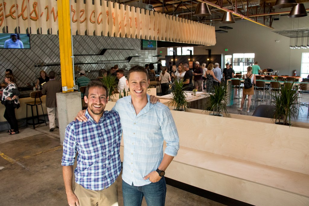 Improper City founders Justin Riley (left) and Hank Grant pose for a portrait during the soft opening of their new RiNo location. Five Points, July 9, 2018. (Kevin J. Beaty/Denverite)