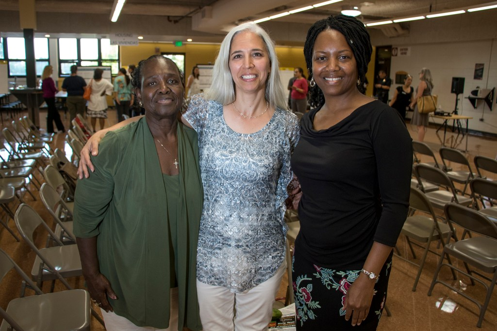 Ann White (left to right), Rose Thomas and Djuana Harvell pose for a portrait. A meeting for comments on an early draft of the Far Northeast Area Plan at the Montbello campus cafeteria, July 12, 2018. (Kevin J. Beaty/Denverite)