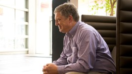 Secretary of State Wayne Williams speaks with a reporter in the Wells Fargo building on Broadway, which houses his office, July 18, 2018. (Kevin J. Beaty/Denverite)