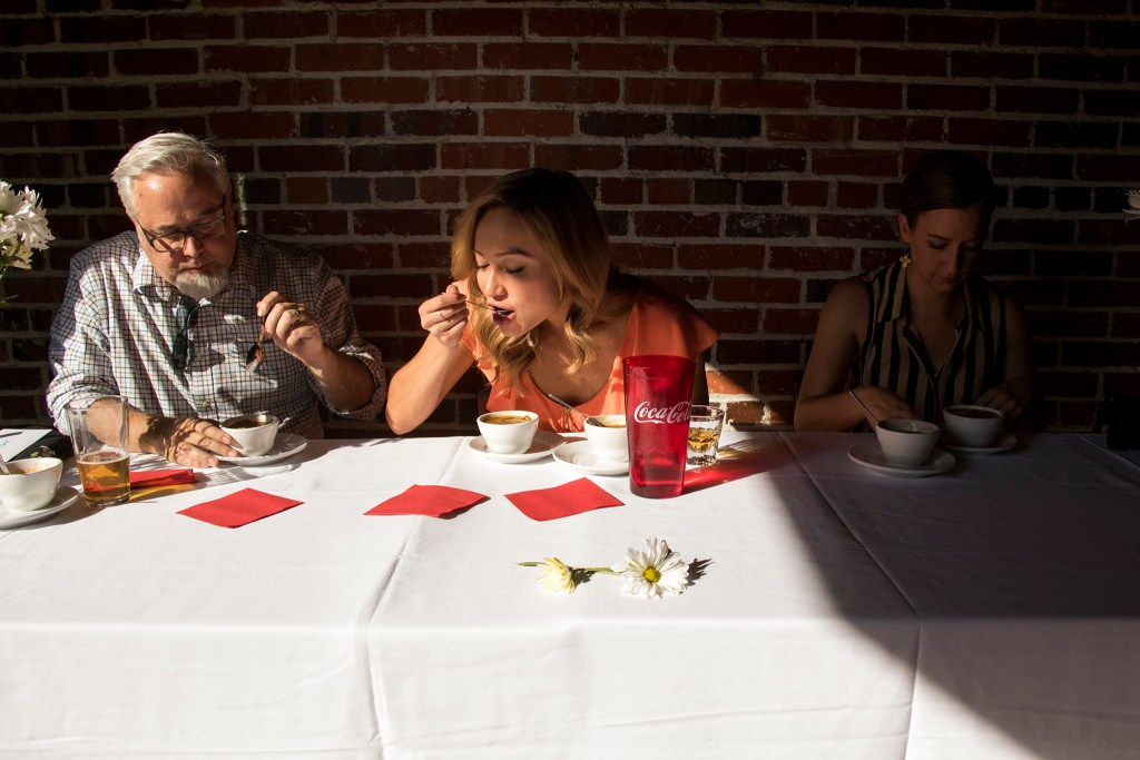 Cherry Cricket chile cookoff judges Mark Antonation (left to right), Katie LaSalle and Amy Brothers perform their duties, July 19, 2018. (Kevin J. Beaty/Denverite)