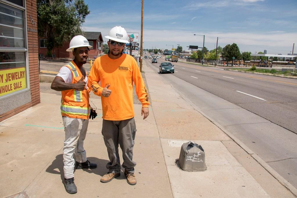 Charles Sims (left) and Randy DeVargas pose for a portrait along Federal Boulevard, July 20, 2018. (Kevin J. Beaty/Denverite)