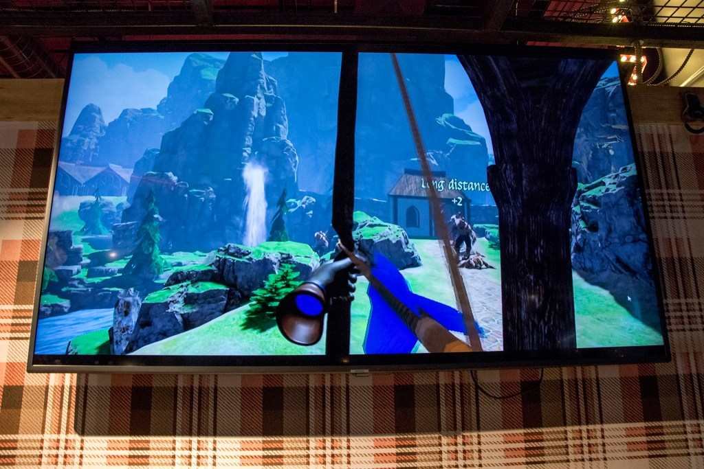 """""""Elven Assassin"""" on the screen inside the new virtual reality parlor open at Punch Bowl Social Broadway, July 18, 2018. (Kevin J. Beaty/Denverite)"""