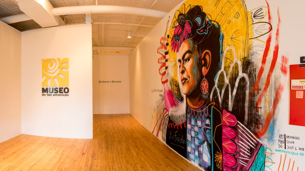 A portrait of Frida Kahlo by Armando Silva on the wall at Museo de las Americas, July 25, 2018. (Kevin J. Beaty/Denverite)