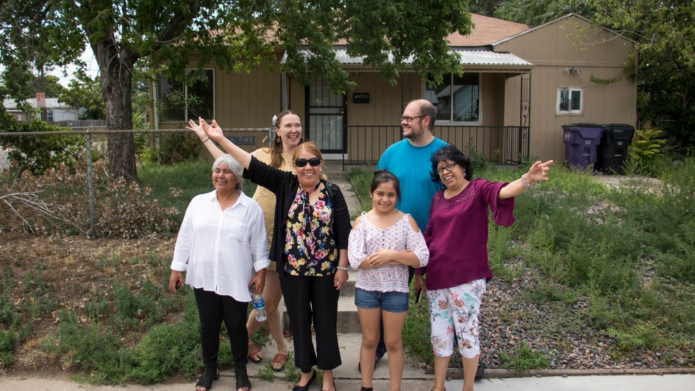 Members of the GES Coalition Organizing for Health and Housing Justice Angelina Torres (left to right), Nola Miguel, Mercedes Gonzalez and her granddaughter Rachel, Robin Reichhardt and Maria De Luna Jimenez pose for a photo in front of a property they acquired in Elyria Swansea, July 26, 2018. (Kevin J. Beaty/Denverite)