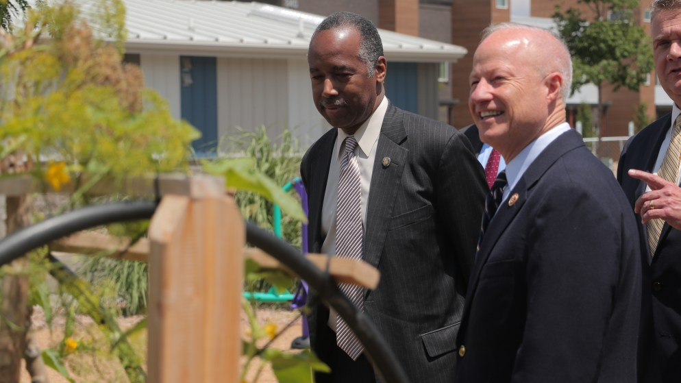 U.S. Housing and Urban Development Secretary Ben Carson and U.S. Rep. Mike Coffman during a tour of a housing complex in Aurora on Monday, July 30, 2018. (Esteban L. Hernandez/Denverite)