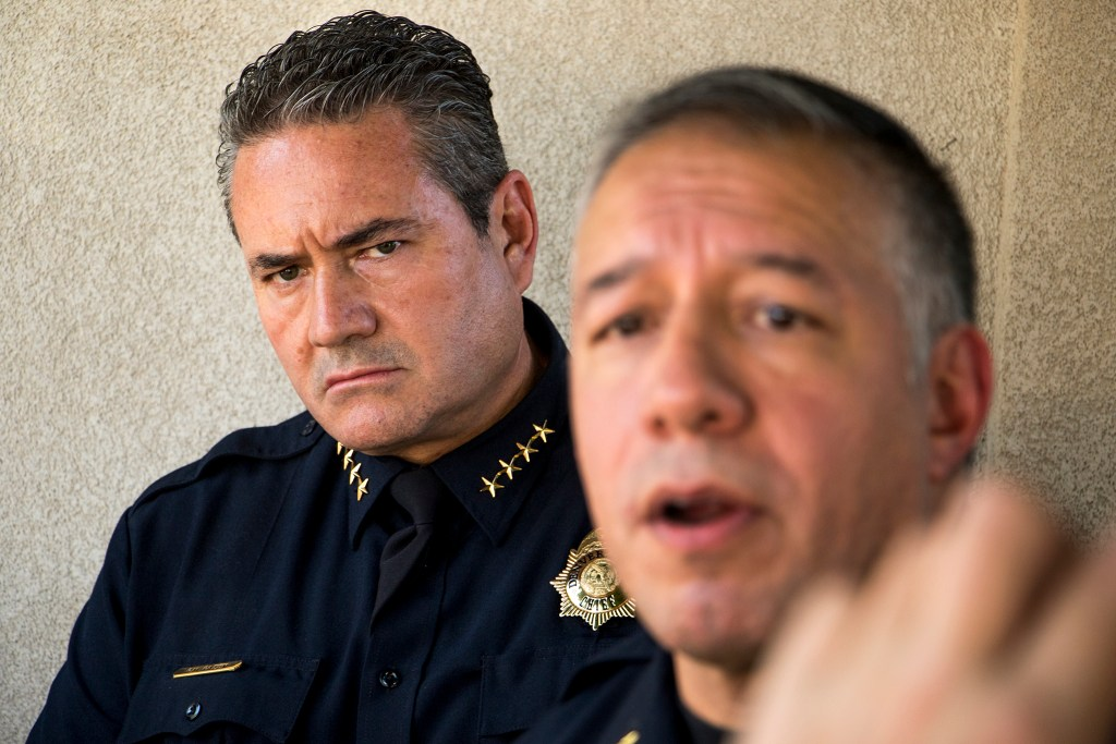 Denver Police Chief Paul Pazen (left) listens to Division Chief of Investigation Joe Montoya address the press as officers investigate a triple homicide close to Broadway at Ohio Avenue, Aug. 9, 2018. (Kevin J. Beaty/Denverite)