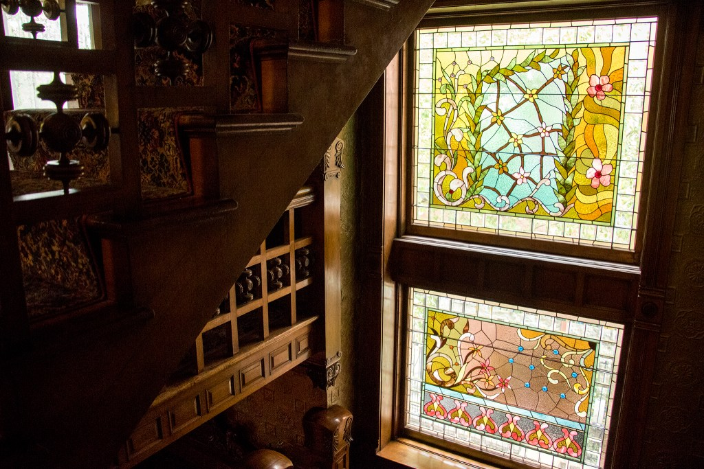 Stained glass windows that were fixed up by Phil Watkins, whose family have been glassmakers in Denver dating back to the time these were installed. Three years of renovations on the Molly Brown House are finally complete, Aug. 21, 2018. (Kevin J. Beaty/Denverite)