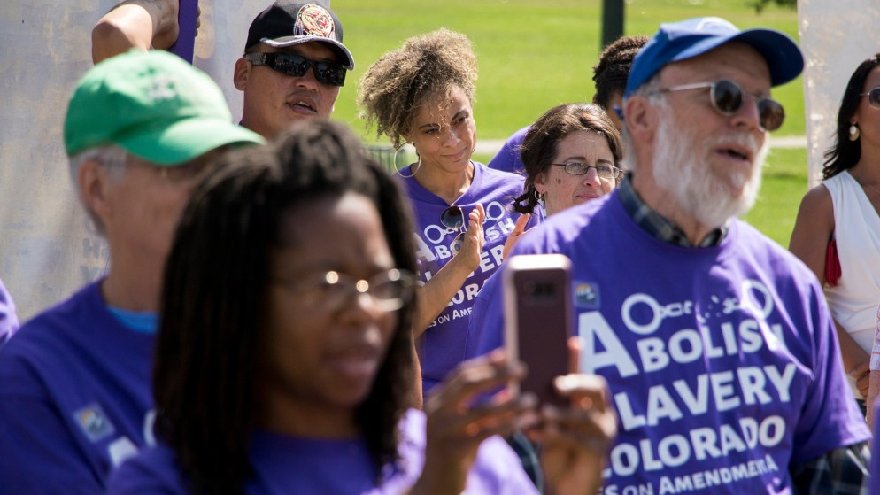 "Elisabeth Epps attends a rally to vote ""yes"" on Amendment A, to make slavery unconstitutional in Colorado, at City Park, Aug. 28, 2018. (Kevin J. Beaty/Denverite)"