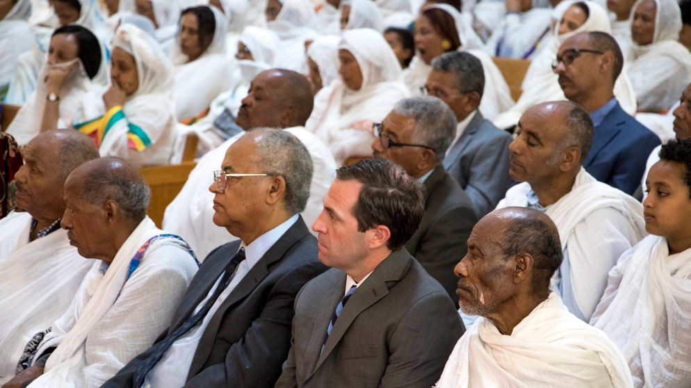 U.S. House candidate Jason Crow sits in during an Ethiopian New Year service at St. Mary Ethiopan Orthodox Church in Aurora, Sept. 9, 2018. (Kevin J. Beaty/Denverite)