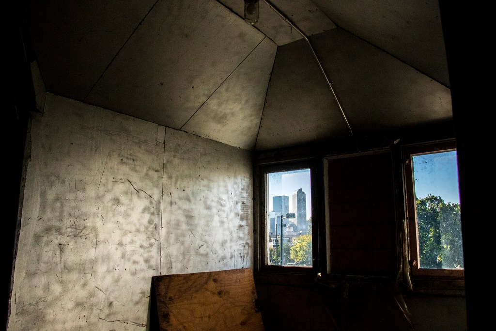 A view of downtonwn from inside a historic home on East Colfax Avenue that has been long shuttered, Sept. 14, 2018. (Kevin J. Beaty/Denverite)