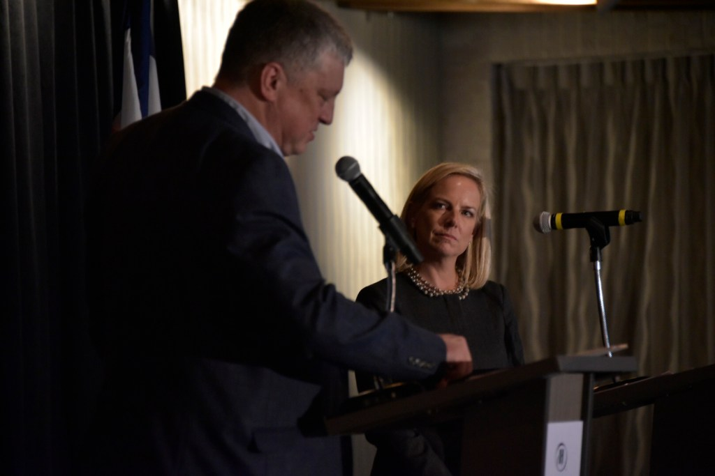 U.S. Department of Homeland Sec. Kirstjen Nielsen looks on as Colorado Secretary of State Wayne Williams speaks during a lunch following an election preparedness exercise on Thursday, Sept. 5, at the Hilton Denver Inverness in Englewood. Photo courtesy of the Secretary of State's office.