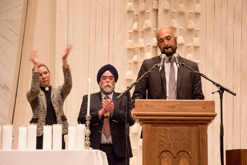 Qusair Mohamedbhai, general council for the Colorado Muslim Society, speaks during a vigil at Temple Emanuel in Denver's Hilltop neighborhood for the victims in a mass shooting at a Pittsburgh synagogue, Oct. 28, 2018. (Kevin J. Beaty/Denverite)
