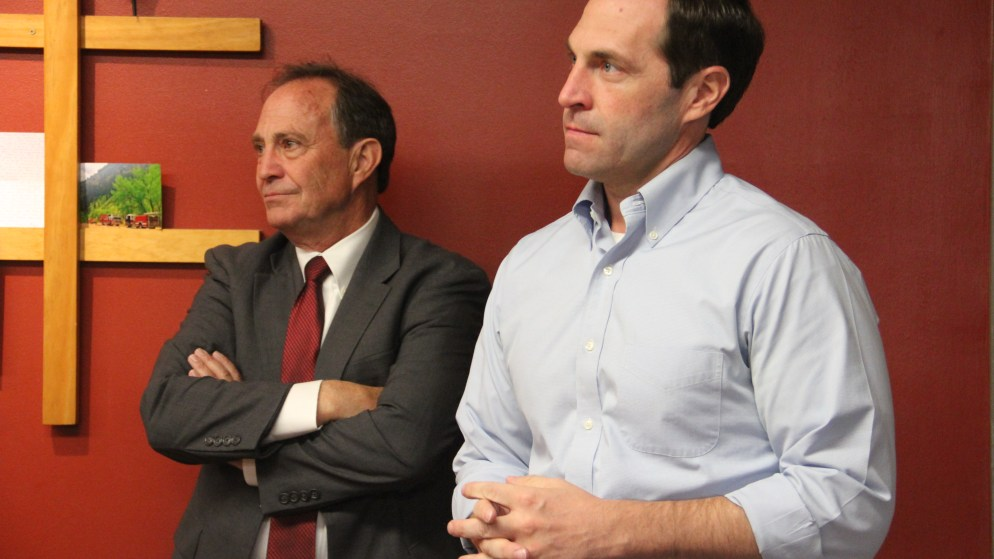 Jason Crow (right) stands next to U.S. Rep. Rep. Ed Perlmutter during a campaign stop at an Aurora Fire Department station on Monday, Oct. 15, 2018. (Esteban L. Hernandez/Denverite)