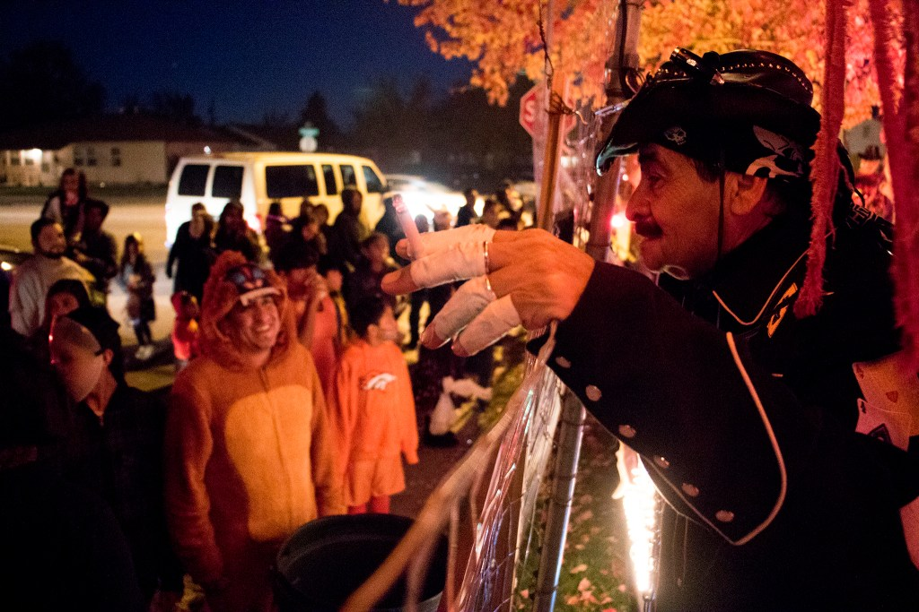 Johnny Lee Sandoval speaks to his audience during a short break from his maniacal Halloween puppet show, Oct. 31, 2018. (Kevin J. Beaty/Denverite)