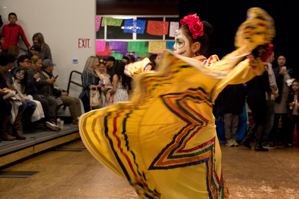 Ana Victoria (9) performs during a Dia de los Muertos celebration at the People's Building in Aurora, Nov. 1, 2018. (Kevin J. Beaty/Denverite)