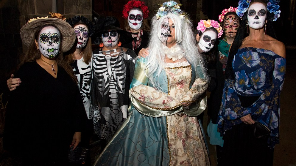 Women dressed for a Dia de los Muertos parade pose for a portrait. First Friday, La Alma Lincoln Park, Nov. 2, 2018. (Kevin J. Beaty/Denverite)