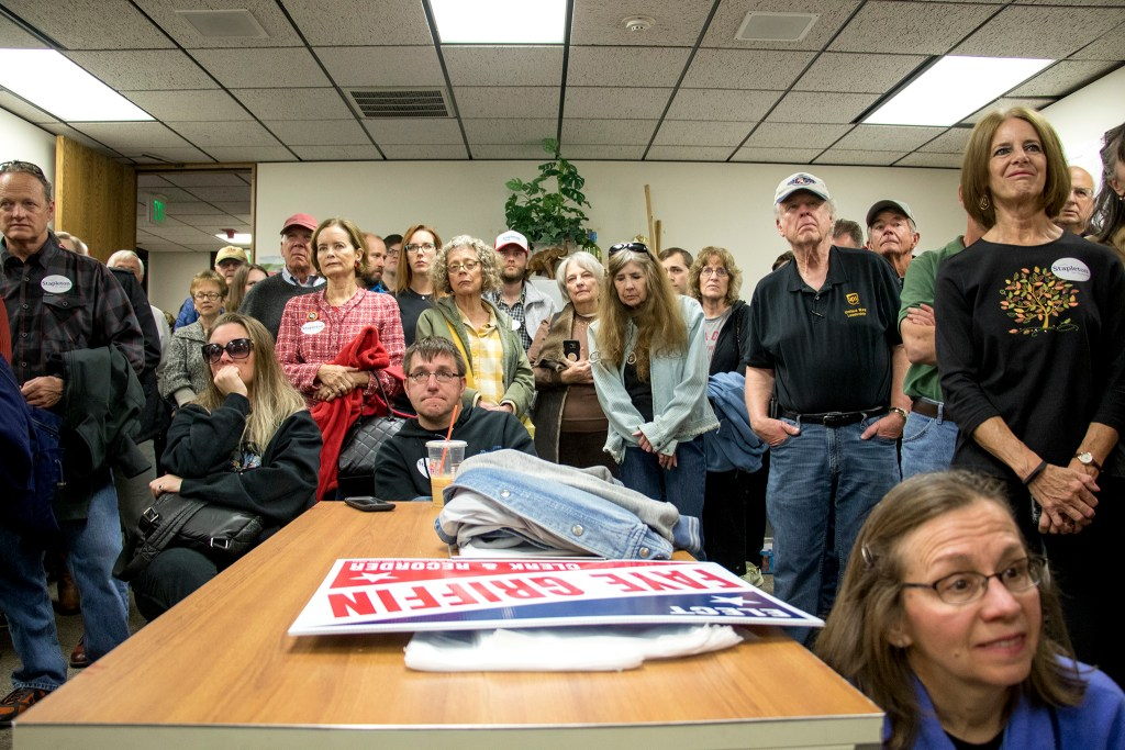 The crowd listens as a slate of Republican candidates rally at Jefferson County GOP headquarters just days before the election, Nov. 3, 2018. (Kevin J. Beaty/Denverite)