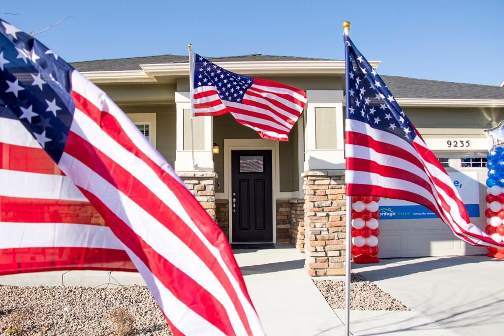 American flags cover Herbert Jackson's new home in Commerce City, Nov. 9, 2018. (Kevin J. Beaty/Denverite)